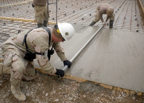 2 men levelling a floor screed
